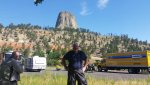 John in front of Devils Tower pull over.jpg